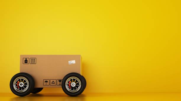 Cardboard box with racing wheels like a car on a yellow background picture id1171982950?b=1&k=6&m=1171982950&s=612x612&w=0&h=nb8x01y1xjnw2qjkkwyfhsgjmbqrflhheynwhaumeke=