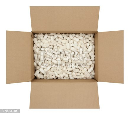 Open cardboard box filled with styrofoam shipping peanuts. Isolated on white background.Please also see my lightbox: