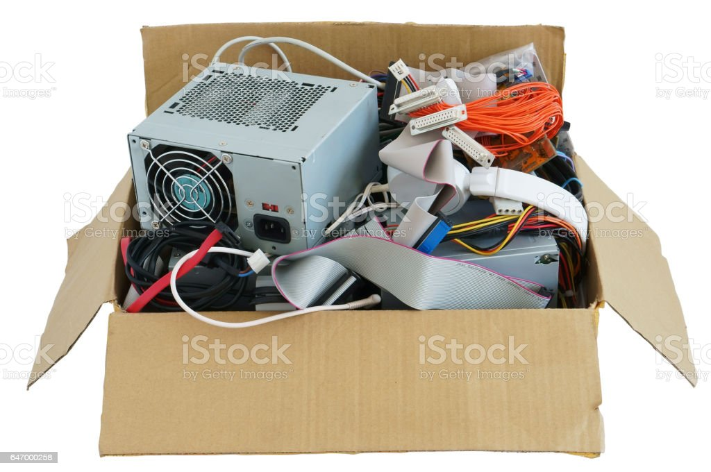 Cardboard box with the old used computer stuff  waste and garbage. Isolated with patch stock photo