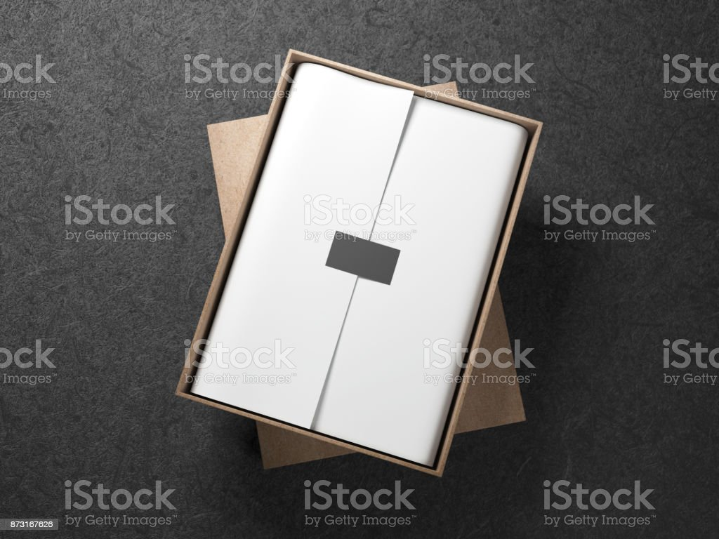 Cardboard Box with White wrapping paper and black label sticker stock photo