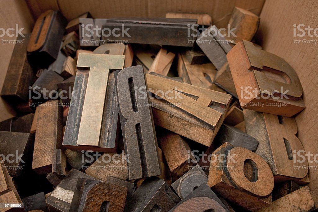 Cardboard box with wooden letters royalty-free stock photo