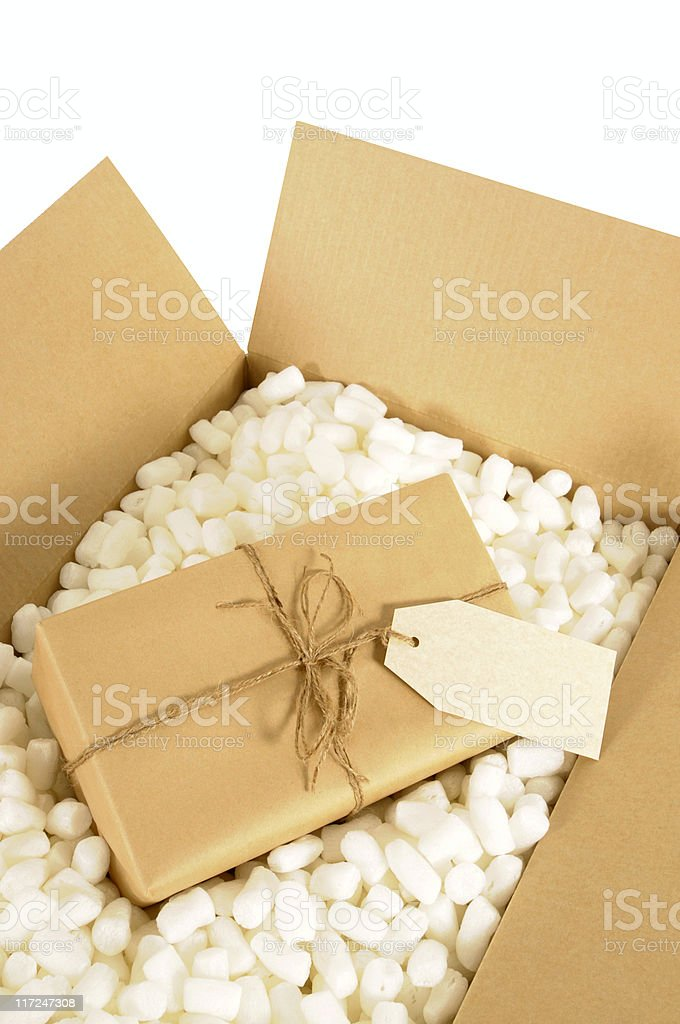 Cardboard box with wrapped package royalty-free stock photo