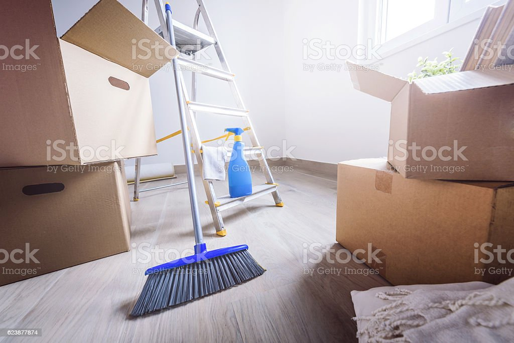 Cardboard boxes and cleaning things for moving into new home stock photo