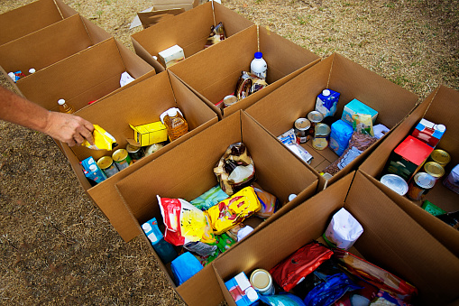 istock Cardboard boxes being filled with food donations 1215291135