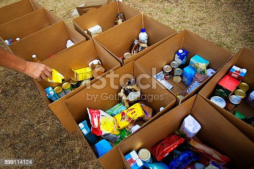 istock Cardboard boxes being filled with food donations 899114124