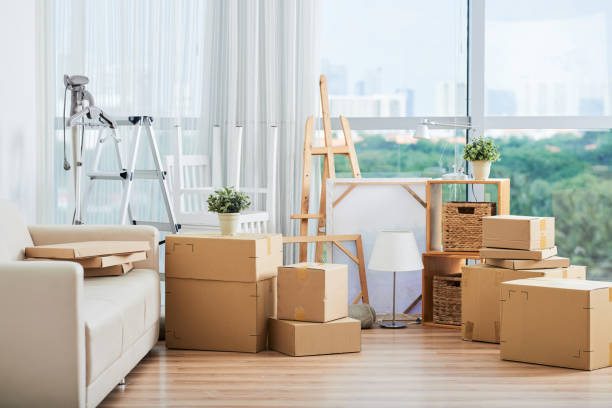 cardboard boxes for moving and drawing easels - physical activity stock photos and pictures
