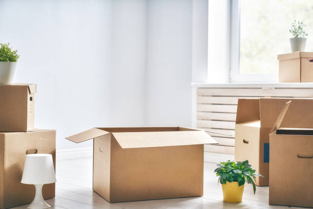 cardboard boxes in room - relocation stock photos and pictures