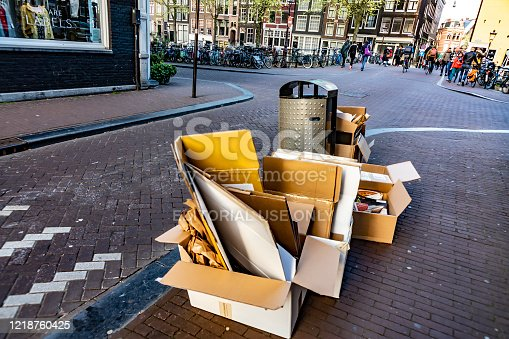 Amsterdam, Netherlands - Apr, 2019: Lots of cardboard boxes stacked in the street.