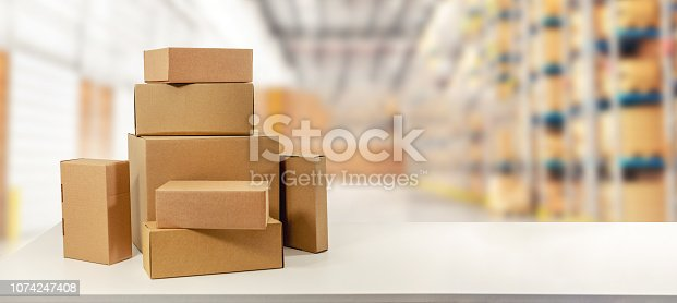 istock cardboard boxes in warehouse ready for transportation and delivery. copy space 1074247408