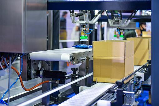 Cardboard boxes on conveyor belt. parcels transportation system concept
