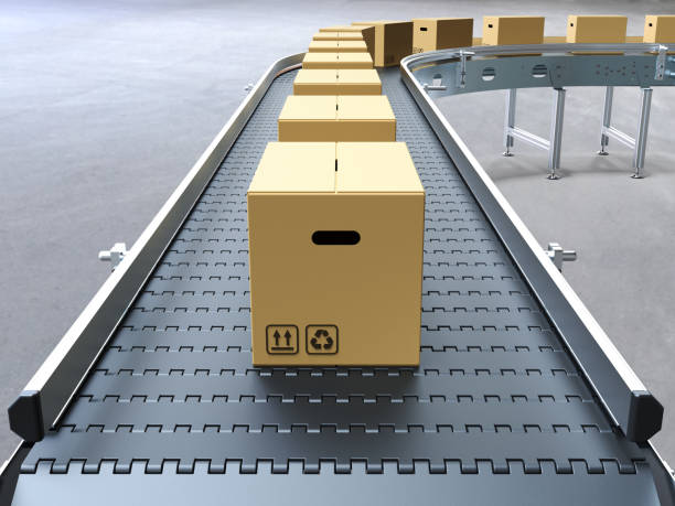 cardboard boxes on conveyor belt - conveyor belt stock pictures, royalty-free photos & images