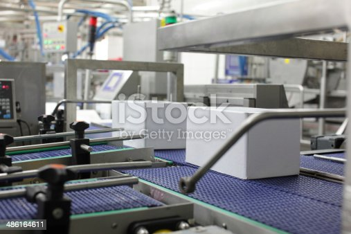 istock Cardboard boxes on conveyor belts in plant 486164611