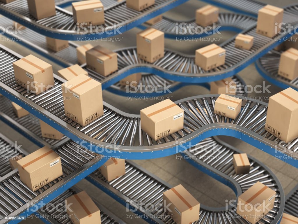 Cardboard boxes on conveyor roller in distribution warehouse, Delivery and packaging service concept background. stock photo