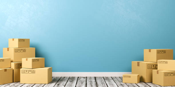 cardboard boxes on wooden floor - physical activity stock photos and pictures
