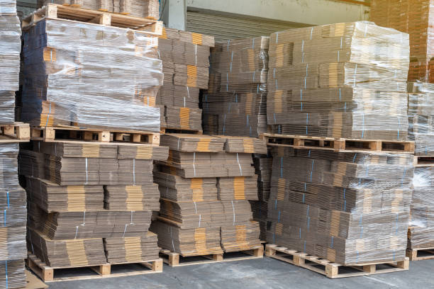 Cardboard boxes on wooden pallet in warehouse stock photo