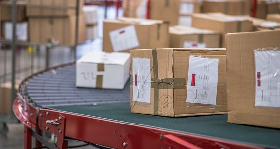 Cardboard boxes package on conveyor belt