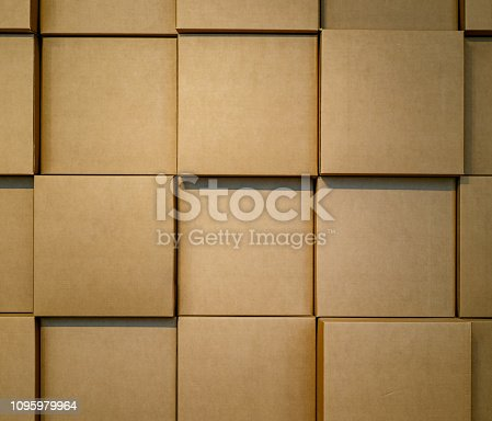 Cardboard boxes stacked in a wall. Background