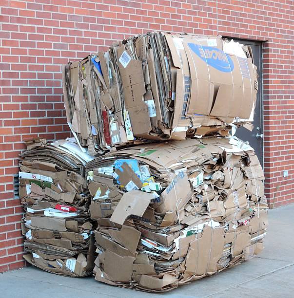 Cardboard Boxes Cardboard Boxes compactor stock pictures, royalty-free photos & images