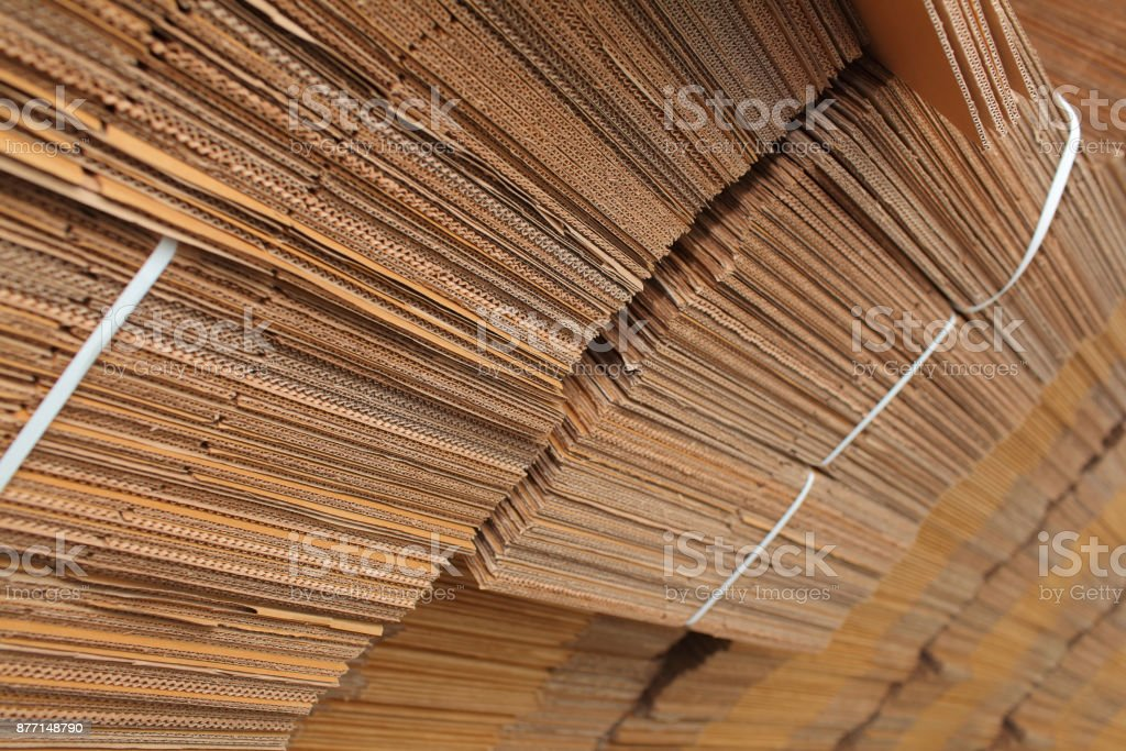 Cardboard boxes stacked in the warehouse stock photo