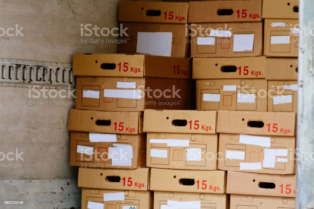 Cardboard boxes stacked inside a postal distribution truck stock photo