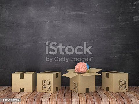 istock Cardboard Boxes with Human Brain in Room - Chalkboard Background - 3D Rendering 1132995869