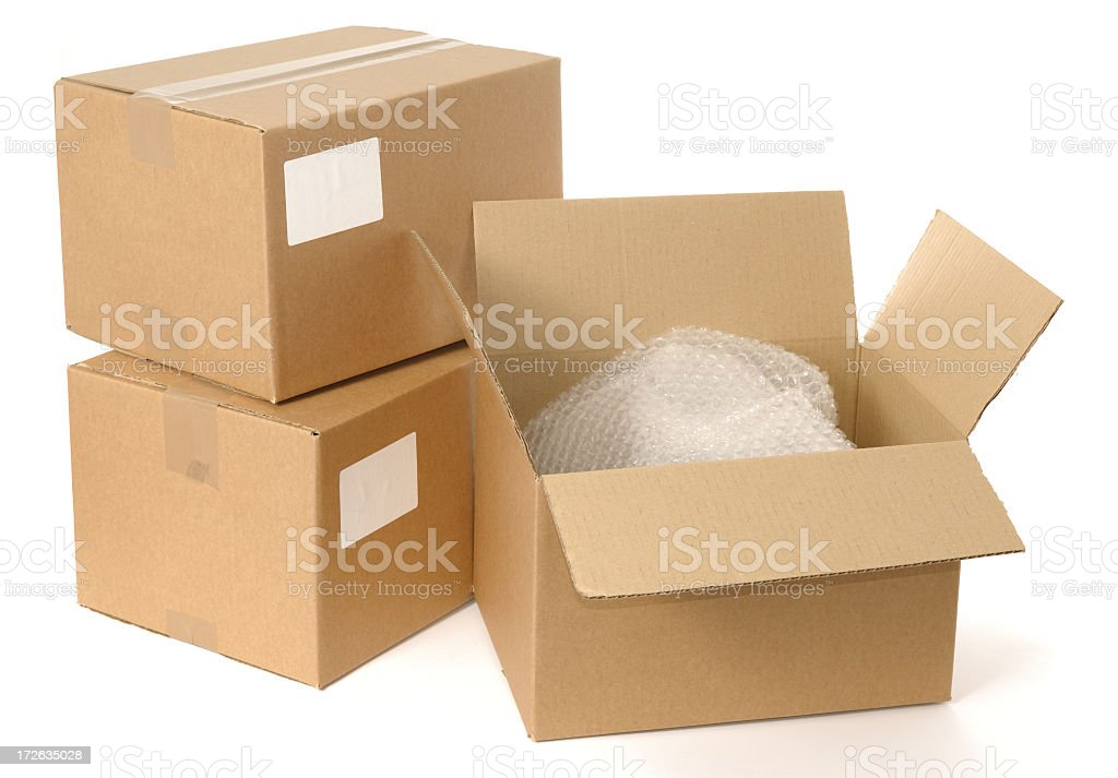 Cardboard boxes with packing materials shown royalty-free stock photo