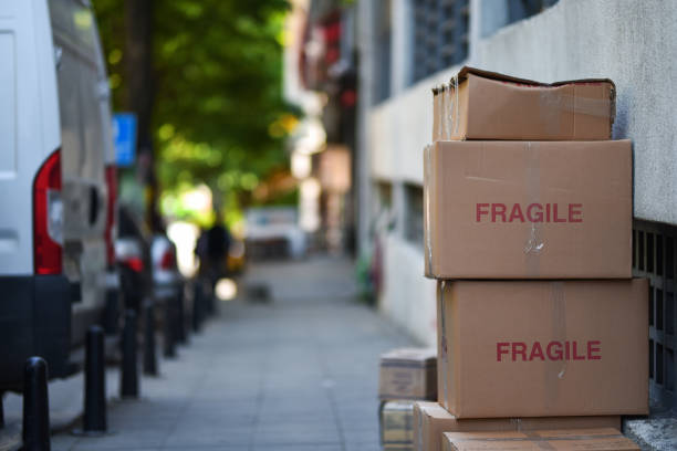 cardboard boxes with sign fragile stock photo
