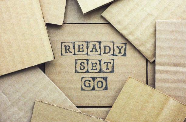 Cardboard card with words Ready Set Go stock photo
