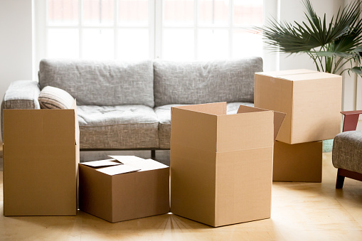 istock Cardboard carton boxes in living room, packing and moving concept 938682818