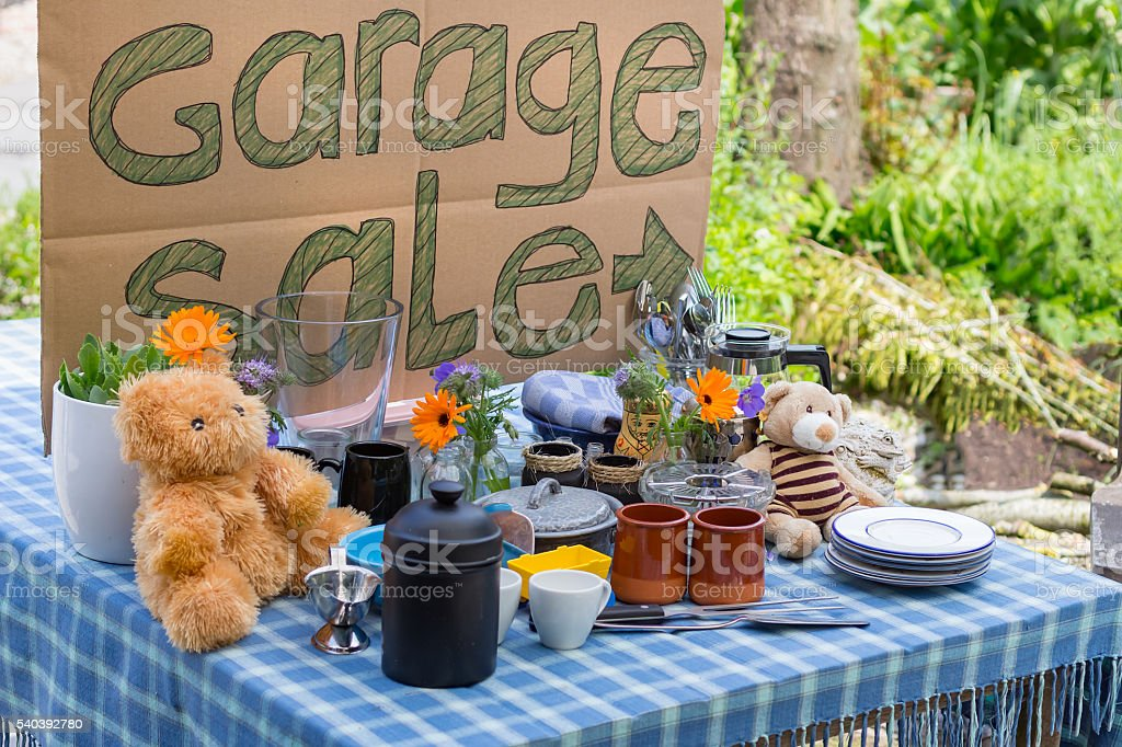 Cardboard Garage Sale on table stock photo