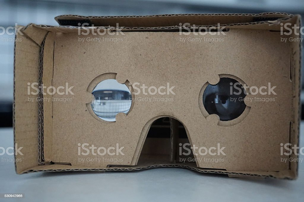Cardboard headset for virtual reality with glass lenses stock photo