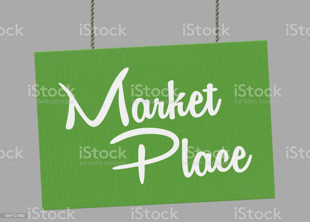 Cardboard market place sign hanging from ropes. Clipping path included so you can put your own background. stock photo