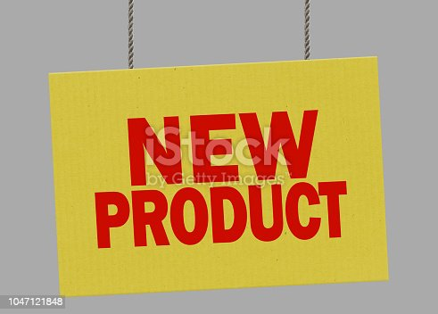 istock Cardboard new product sign hanging from ropes. Clipping path included so you can put your own background. 1047121848