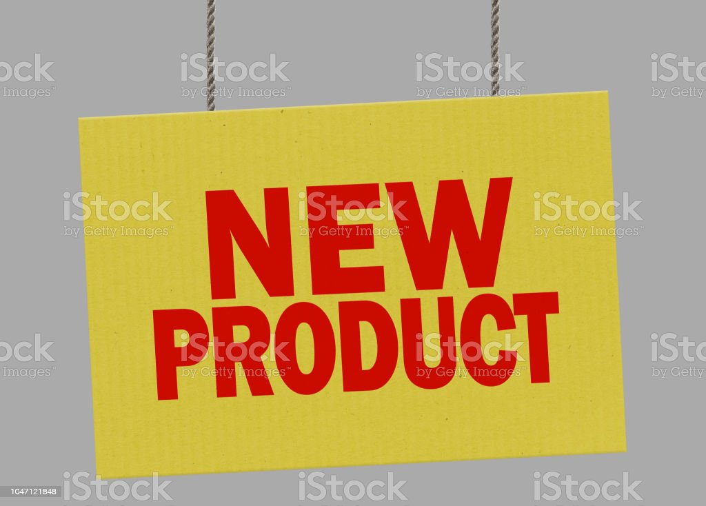 Cardboard new product sign hanging from ropes. Clipping path included so you can put your own background. stock photo