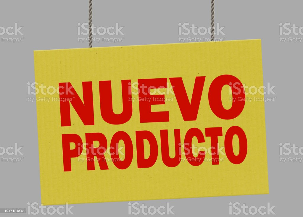 Cardboard nuevo producto sign hanging from ropes. Clipping path included so you can put your own background. stock photo