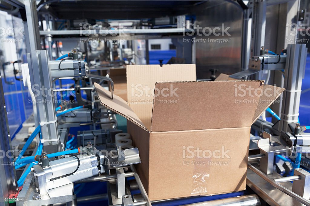Cardboard package box packing machine stock photo