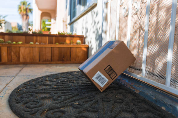 cardboard package delivery at front door - thief stock photos and pictures