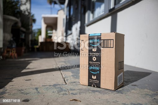 Los Angeles CA, November 11/22/2017: Image of an Amazon packages. Amazon is an online company and is the largest retailer in the world. Cardboard package delivery at front door during the holiday season. shipping package parcel box on wooden floor with protection paper inside. Amazon.com went online in 1995 and is now the largest online retailer in the world.