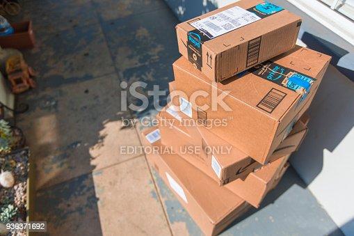 istock Cardboard package delivery at front door 936371692