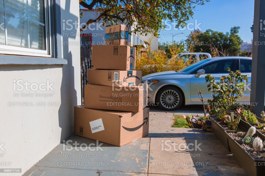 Cardboard package delivery at front door stock photo