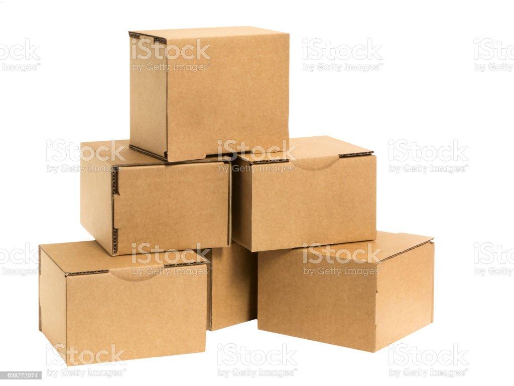 Cardboard pyramid with gaps on White stock photo