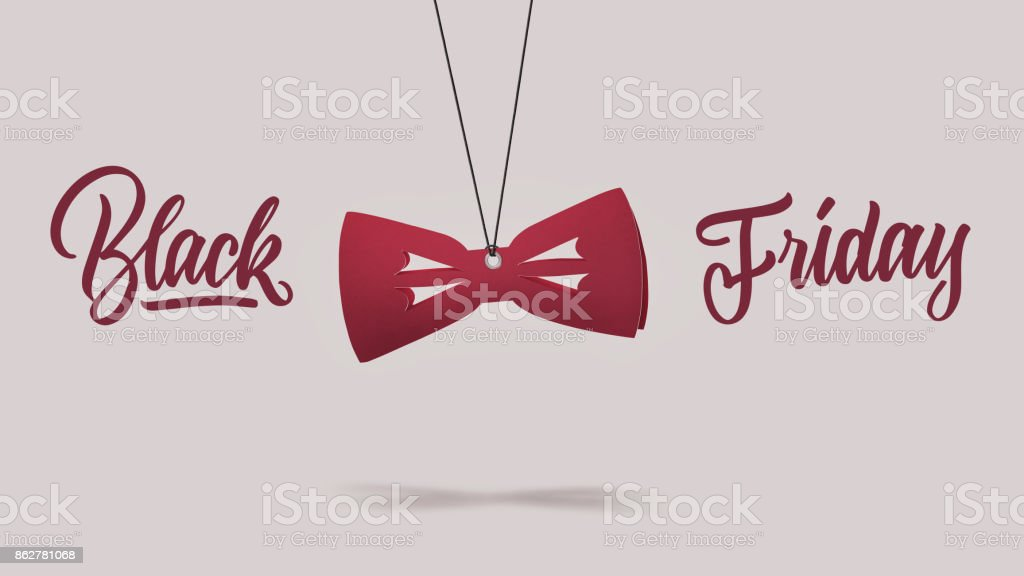 cardboard red bow tie. black Friday concept. stock photo