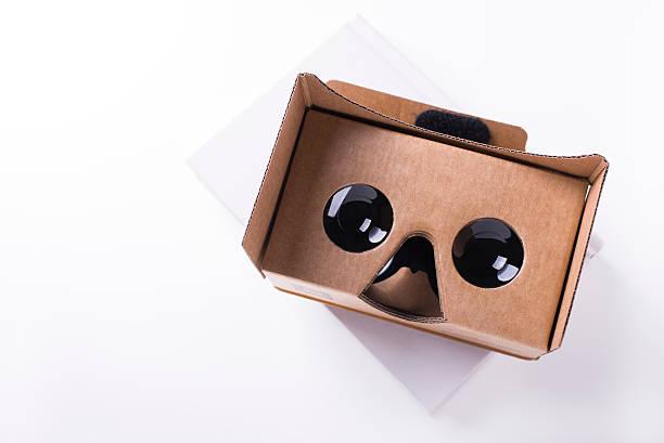 cardboard virtual reality headset over white book stock photo