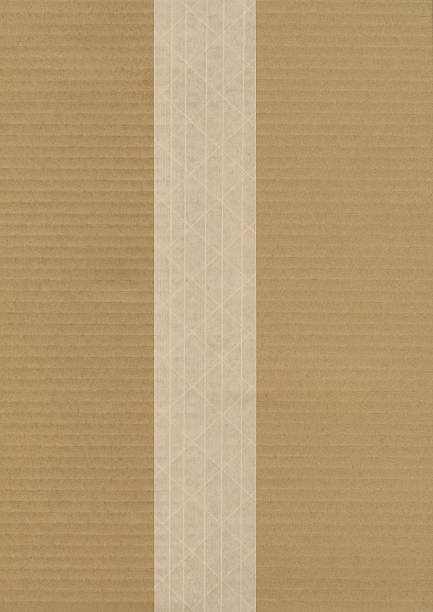 Cardboard With Fiber Reinforced Brown Shipping Tape stock photo