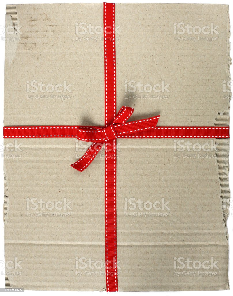 Cardboard with red ribbon royalty-free stock photo