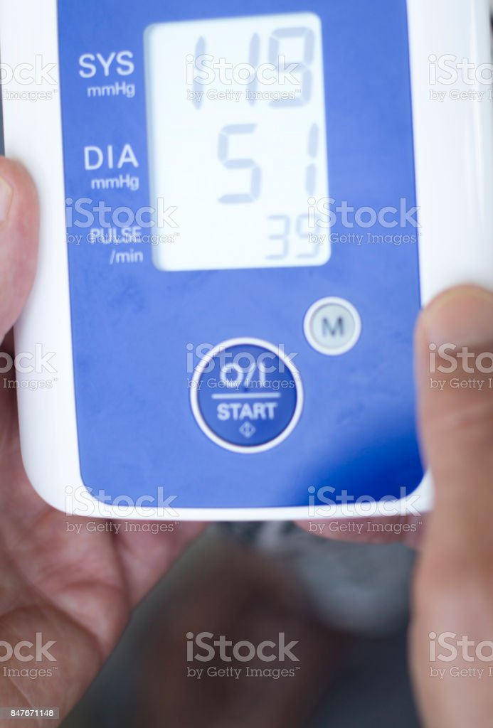 Cardiac blood pressure and irregular heart beat pulse rate meter to show resting heart rate in monitored old aged female patient. stock photo