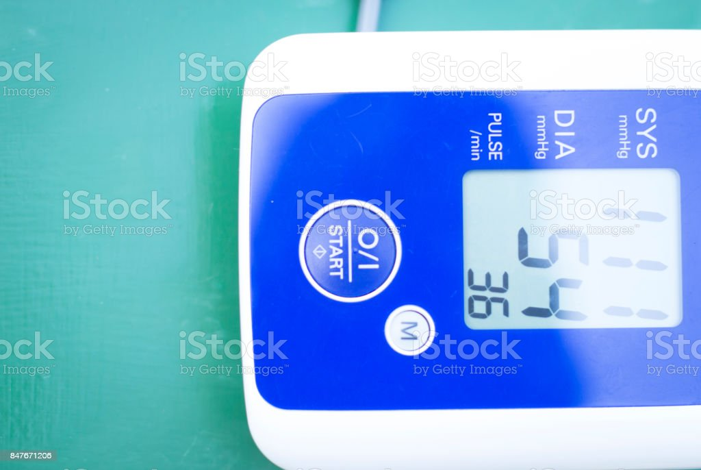 Cardiac blood pressure and irregular heart beat pulse rate notes showing resting heart rate in monitored patient. stock photo