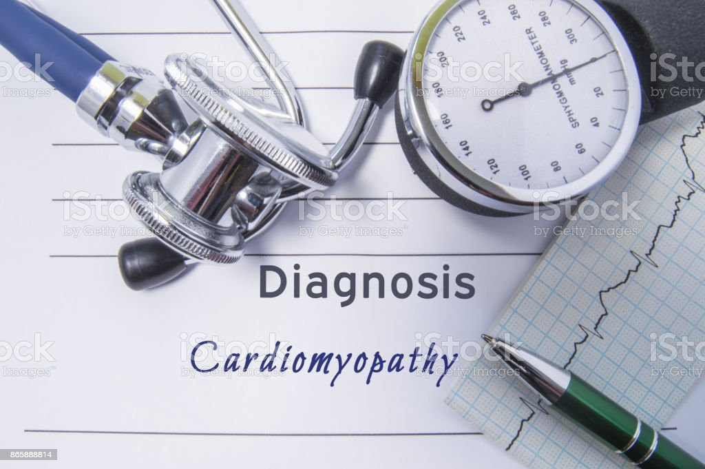 Cardiac diagnosis Cardiomyopathy. Medical form report with written diagnosis of Cardiomyopathy lying on table in doctor cabinet, surrounded by stethoscope, tonometer and ecg. Concept for cardiology stock photo