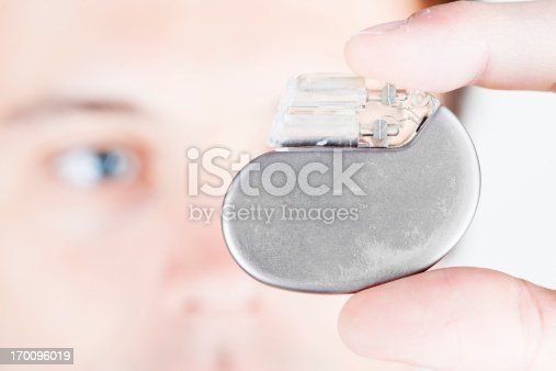 A male person, checking a cardiac pacemaker. XXL size image.