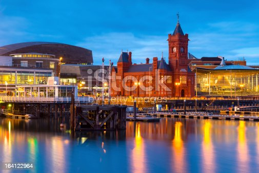 Cardiff Bay at dusk, the Pierhead building (1897) and National Assembly for Wales can be seen over the water.